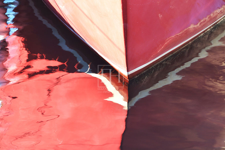 Interior Art painted red boat reflection on blue lake water as abstract fine art photography image by Canadian visual artist Elizabeth Hesp
