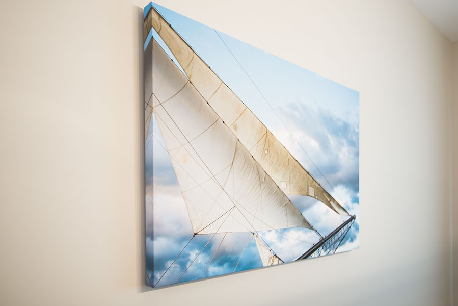 Silver Sails fine art photography giclee canvas in blue and beige from Elizabeth Hesp Fine Art's Sails Tall Ship series installed as interior art on the wall of a model home in Kingston Ontario